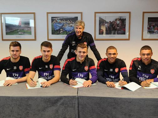 Arsene Wenger is happy as the five players sign new contracts.