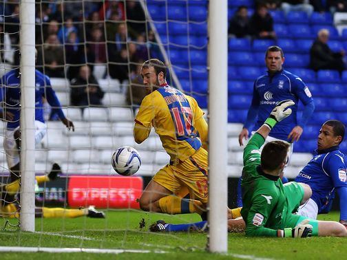 Glenn Murray bundles the ball over the line