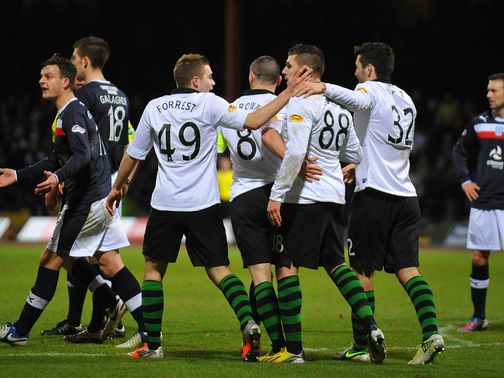 Celtic celebrate their win at Dundee