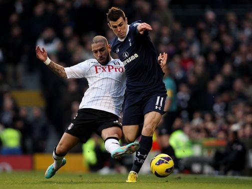 Ashkan Dejagah slides in on Gareth Bale