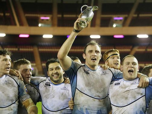 Glasgow skipper Alastair Kellock lifts the 1872 Cup