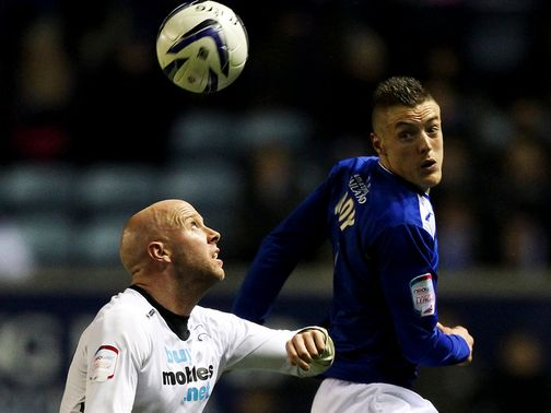 Jamie Vardy heads the ball ahead of James O'Connor