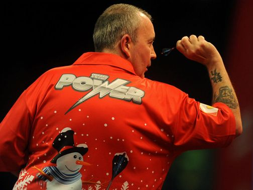 Phil Taylor: Far from his best but safely through