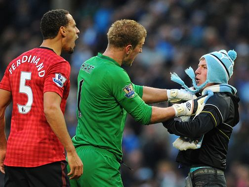 Matthew Stott is restrained by Rio Ferdinand