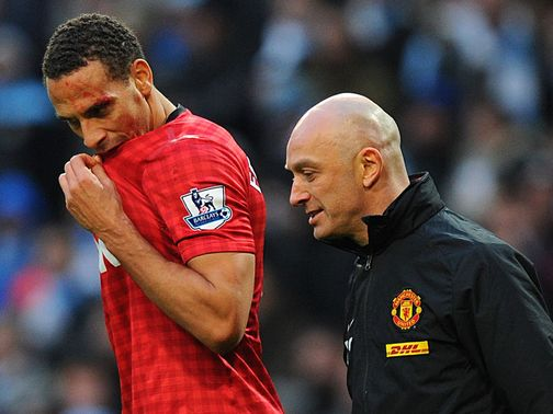 Blood is visible on Rio Ferdinand's face