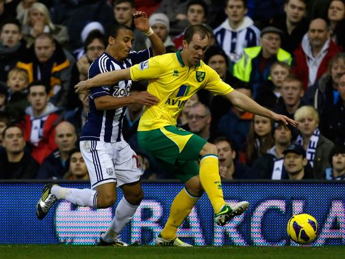 Odemwingie and Whittaker battle for the ball