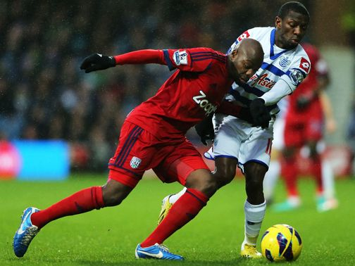 Mulumbu and Wright Phillips battle for possession