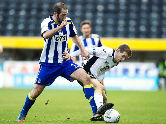 Gary Harkins battles for the ball with Daniel Carmichael