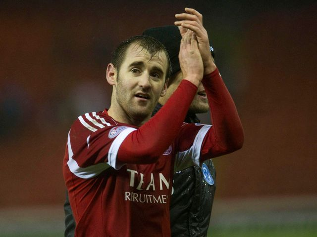 Two-goal Niall McGinn salutes the fans