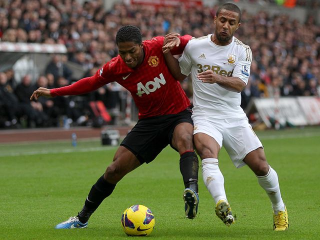 Valencia and Routledge vie for the ball