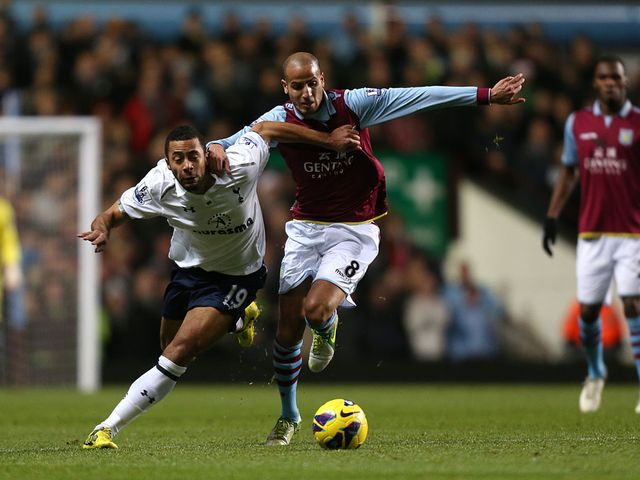 Mousa Dembele and Karim El Ahmadi battle for the ball