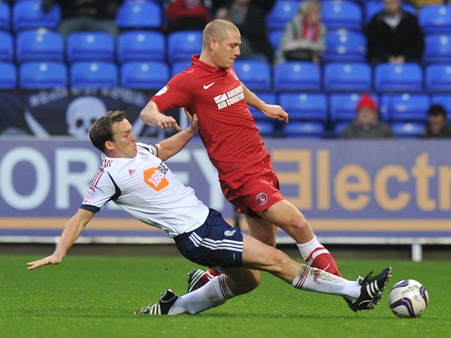 Kevin Davies slides in on Michael Morrison