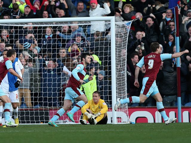Sam Vokes races away to enjoy Burnley's equaliser.