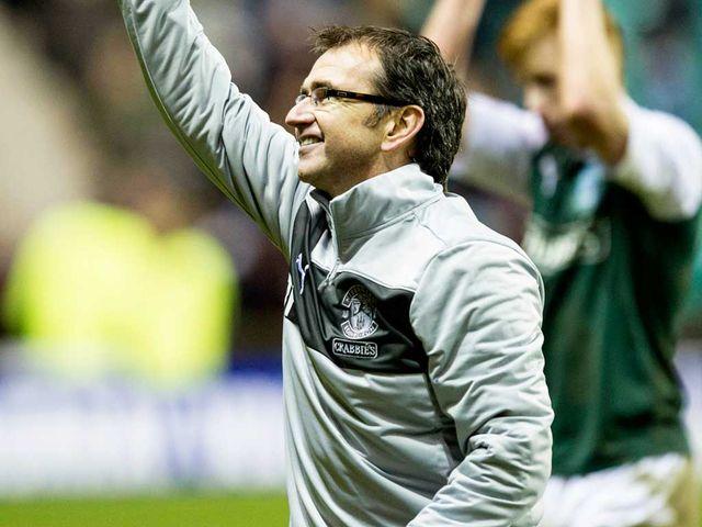 Pat Fenlon celebrates Hibs' victory