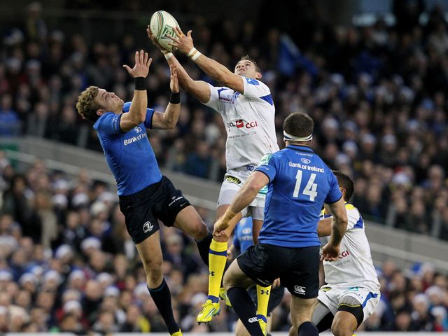 Leinster's Fergus McFadden (left) battles for possession