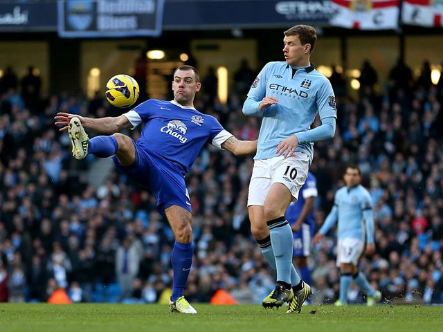 Darron Gibson and Edin Dzeko battle for the ball