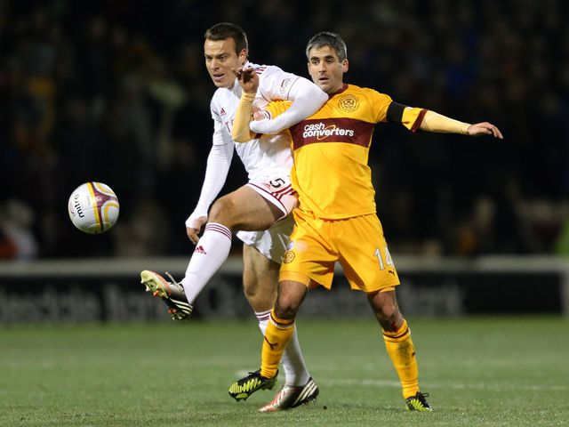 Gavin Rae and Keith Lasley battle for the ball