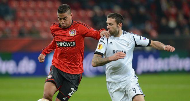 Carlinhos and Rade Prica battle for the ball