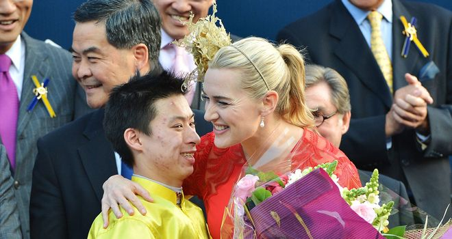 Matthew Chadwick is congratulated by Kate Winslet after winning the Hong Kong Cup