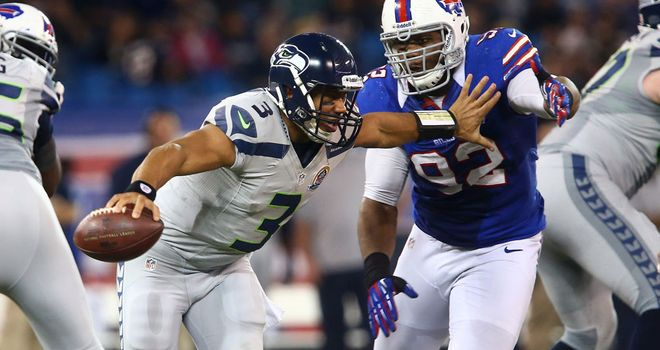 Russell Wilson: Ran for three touchdowns and threw for another in Seattle's comfortable win