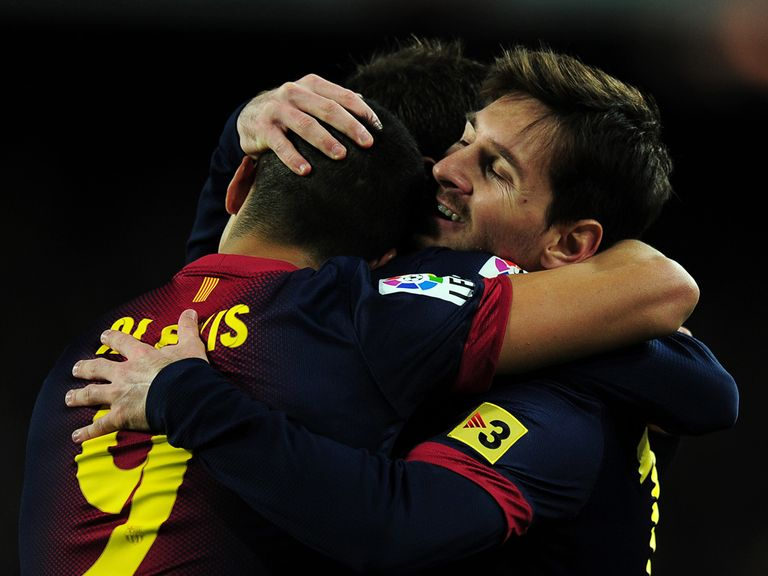Lionel Messi (r) celebrates his first goal