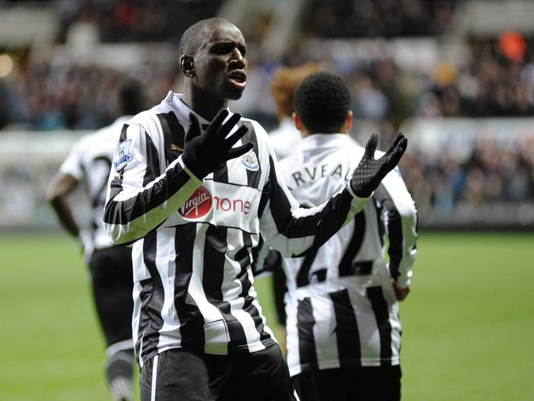 Demba Ba celebrates one of his two goals v Wigan