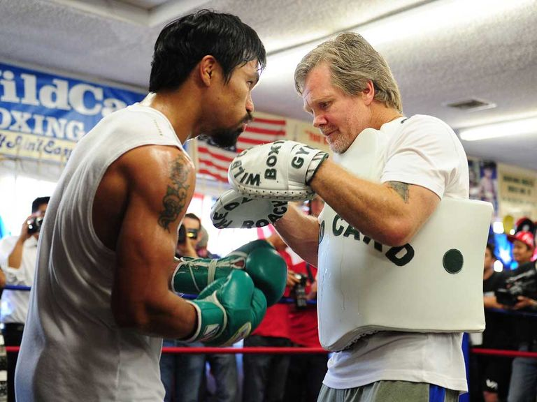 Roach (r) will tell Pacquiao if he thinks he should retire