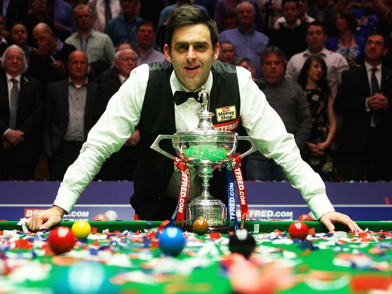 Ronnie O'Sullivan celebrates his fourth world title.