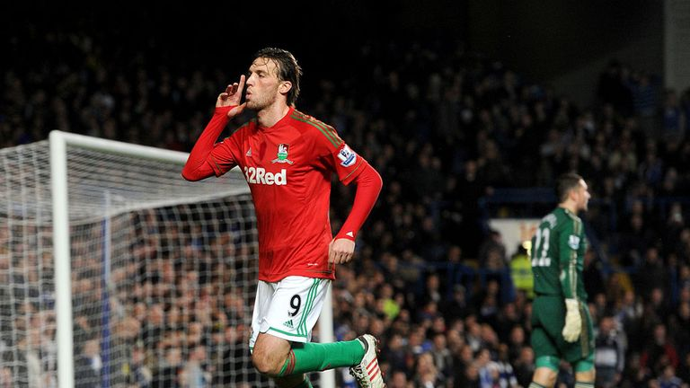 Michu: Celebrates his opener on an unforgettable night for Swansea at Stamford Bridge