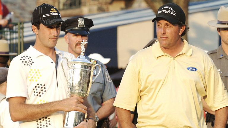 Geoff Ogilvy celebrates as a rueful Mickelson surveys the one that got away