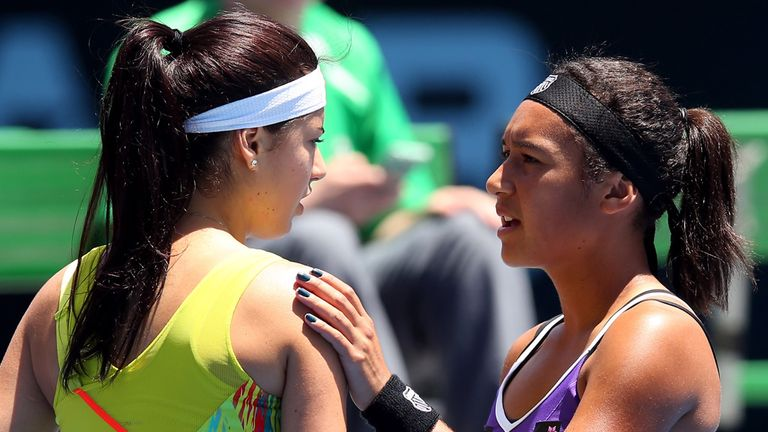 Heather Watson consoles Sorana Cirstea after the Romanian withdrew with illness