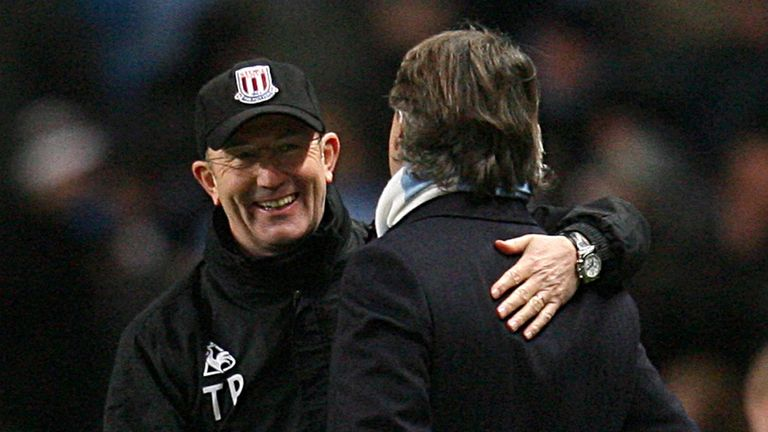 Tony Pulis (left) has no fear ahead of the match with Manchester City