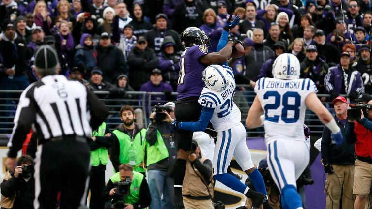 Anquan Boldin holds on for his fourth-quarter touchdown