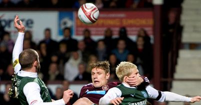 Marius Zaliukas: Sandwiched between Hibs defenders at Tynecastle