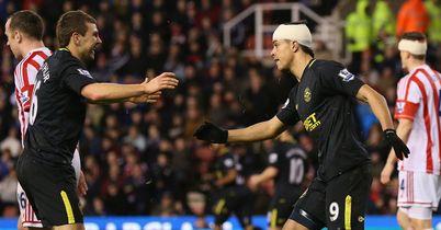 Wigan celebrate a crucial point