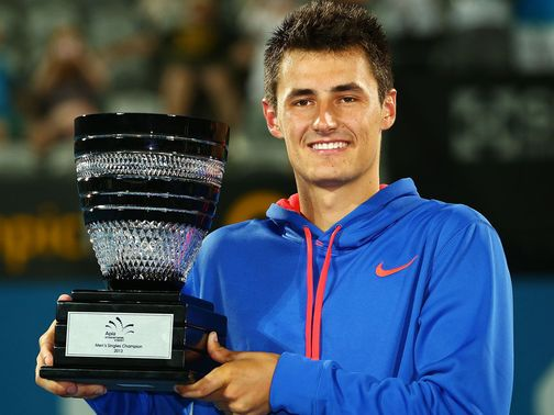 Bernard Tomic with the spoils of victory