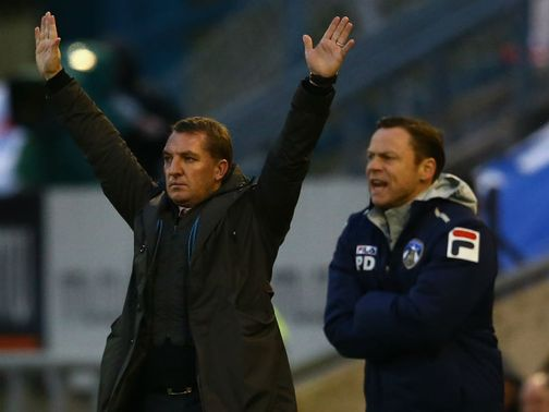Dickov (r) watches his side knock out Premier League Liverpool