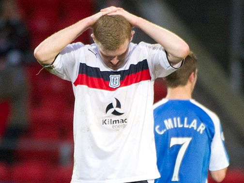 Dejection for Dundee's Brian Easton at full-time