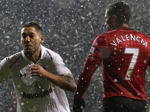 Clint Dempsey celebrates his late leveller for Spurs