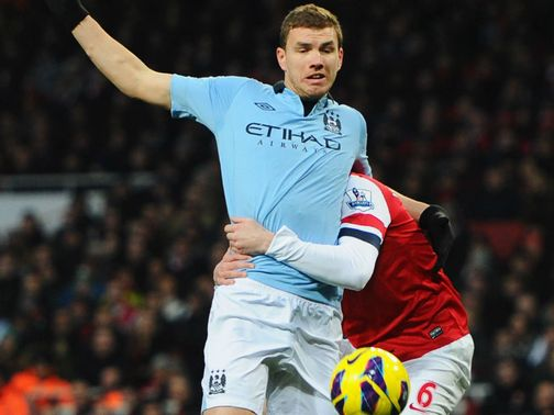 Koscielny was sent off for this foul on Dzeko