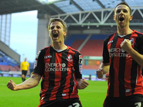 Eunan O&#39;Kane and Marc Pugh celebrate for Bournemouth