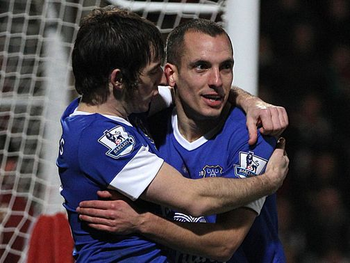 Leon Osman celebrates his goal at Cheltenham