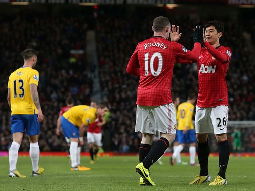 Manchester United lead the Premier League by seven points after beating Southampton.