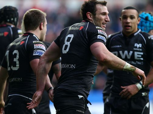 Ospreys celebrate after scoring a try