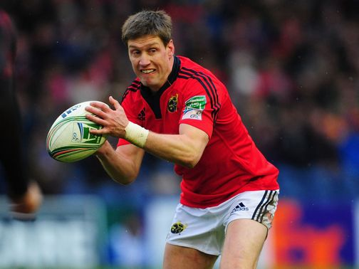Ronan O'Gara looks to get a quick pass away