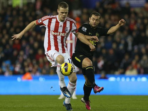Ryan Shawcross and Shaun Maloney battle for the ball