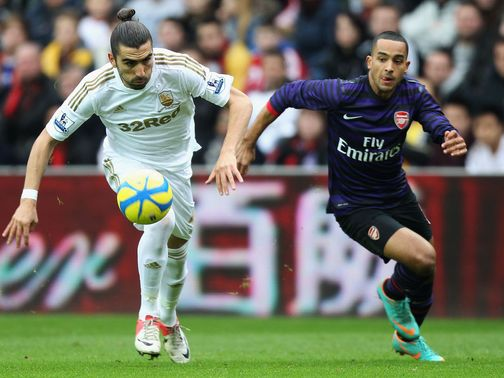 Chico and Theo Walcott battle for the ball
