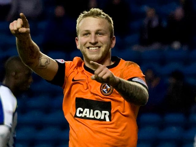 Johnny Russell scored a hat-trick for Dundee United