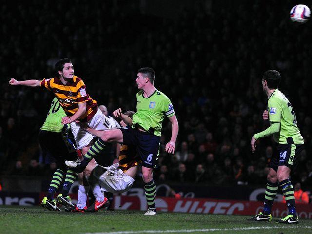 Carl McHugh heads home Bradford's third goal