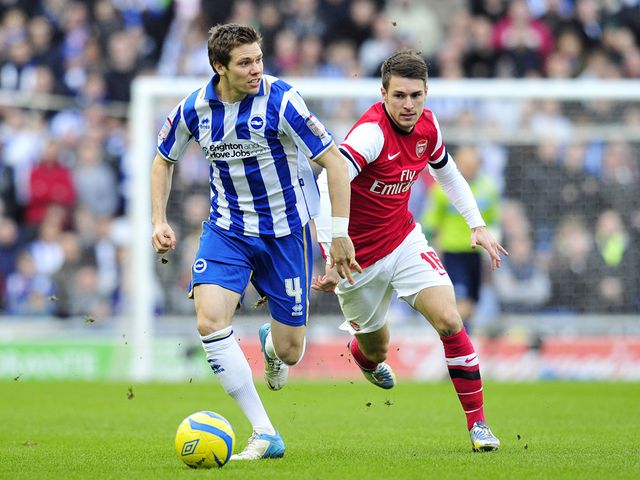 Dean Hammond and Aaron Ramsey battle for the ball
